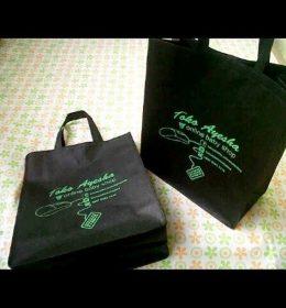 tas spunbond tas berkat hitam sablon hijau