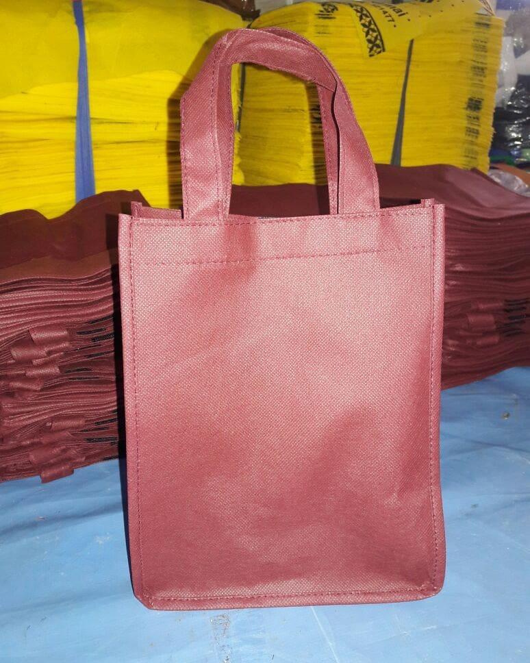 tas spunbond tas berkat merah maroon polos